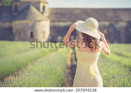 Beautiful girl with hat staring Abbey of Senanque - stock photo