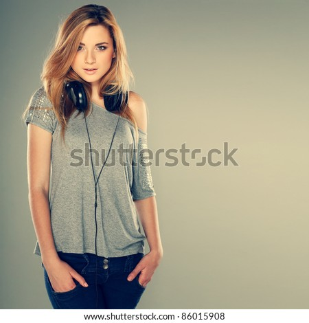 Beautiful girl with headphones - stock photo