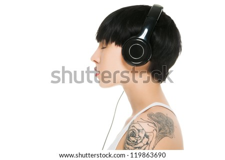 Beautiful girl with headphones isolated on white - stock photo