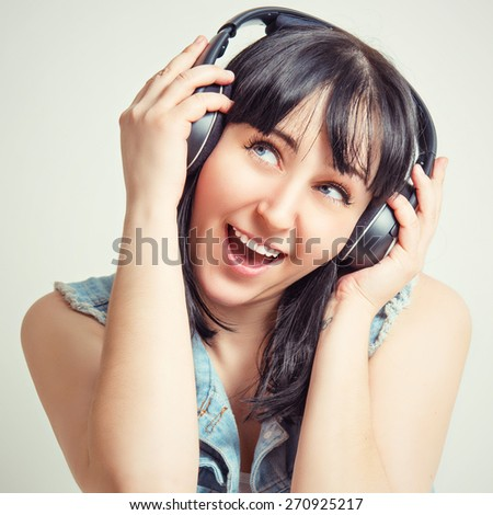 Beautiful girl with headphones listening to music.