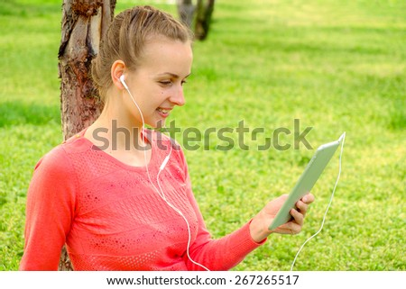 Beautiful girl with headset and tablet