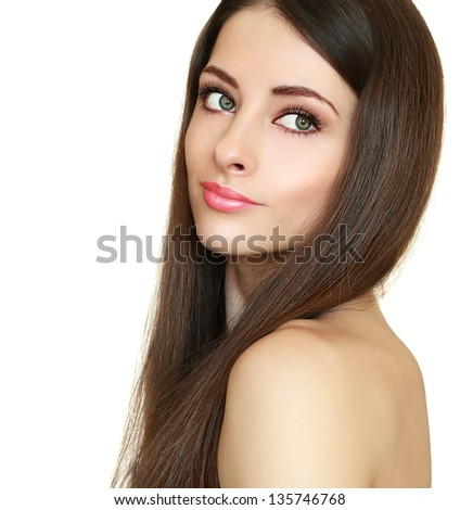 Beautiful girl with health long hair looking calm isolated on white background. Female model with natural makeup and smooth hair