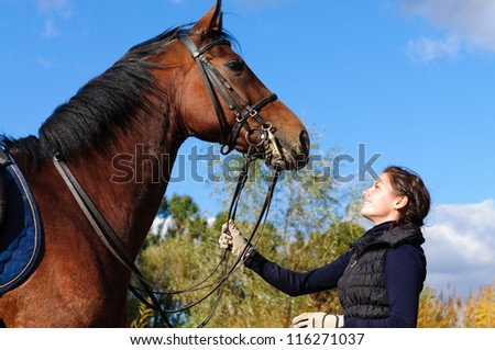 Beautiful girl with her horse.