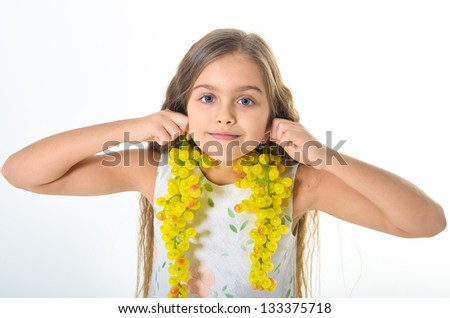 beautiful girl with long clusters of green grapes - white studio
