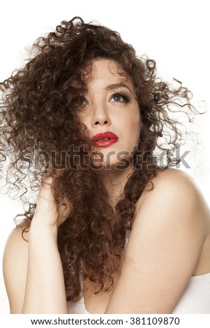 beautiful girl with long curly hair on a white background