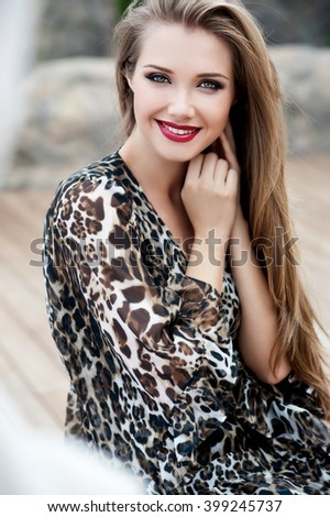 Beautiful girl with long hair. Smiling girl. Young pretty woman with beautiful long hairs and red lips