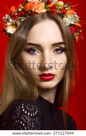 Beautiful girl with long hair wearing a wreath of flowers - stock photo