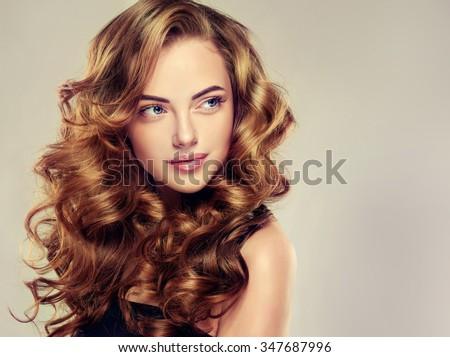 beautiful girl long wavy hair brunette stock photo