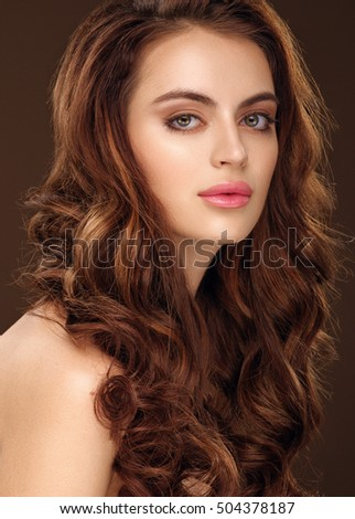 Beautiful girl with long wavy hair. Redhead girl with curly hairstyle