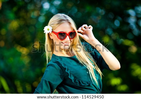 beautiful girl with love glasses outdoor - stock photo