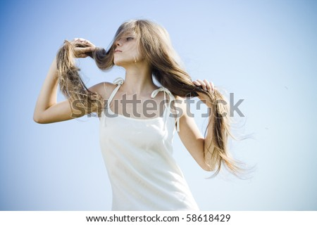 Beautiful girl with luxuriant hair outdoor - stock photo