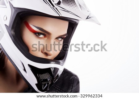 Beautiful girl with makeup in a helmet. - stock photo