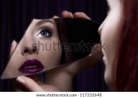 Beautiful girl with mirror