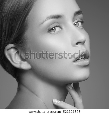 Beautiful girl with natural makeup and white nails. Fashion woman Portrait. Black and white