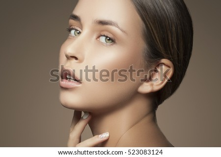 Beautiful girl with natural makeup and white nails. Fashion woman Portrait. Toned