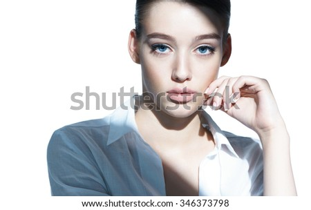 Beautiful girl with natural makeup, youth and skin care concept / close-up of an attractive girl of the European appearance in a white shirt - isolated on white background - stock photo