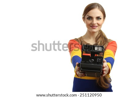beautiful girl with old retro camera in hand isolated - stock photo