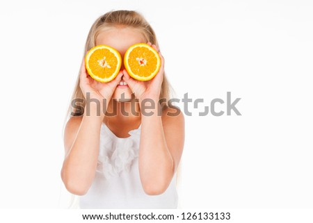 Beautiful girl with oranges, on a gray background
