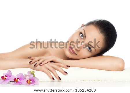 beautiful girl with orchid a perfect skin on a white background - stock photo