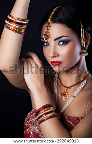 Beautiful girl with oriental makeup and Indian Jewelry, fashion look