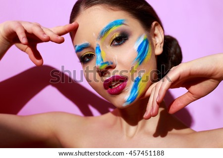 beautiful girl with paint on her face