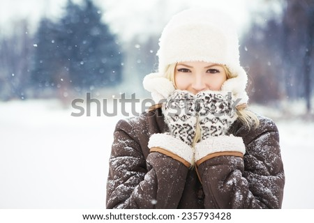 Beautiful girl with perfect skin posing in the park. - stock photo