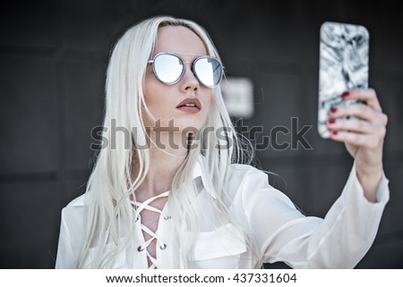 Beautiful girl with phone outdoor - stock photo