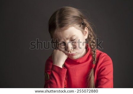Beautiful girl with pigtails wants to sleep - stock photo