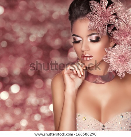 Beautiful Girl With Pink Flowers. Beauty Model Woman Face. Isolated on bokeh lights Background.  Perfect Skin. Professional Make-up. Makeup. Fashion Art.  - stock photo