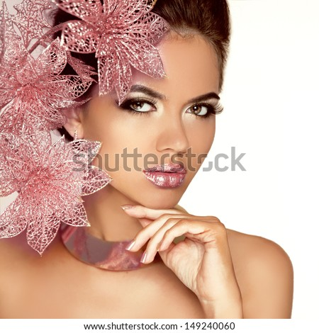 Beautiful Girl With Pink Flowers. Beauty Model Woman Face. Perfect Skin. Professional Make-up. Makeup. Fashion Art. Isolated on white. - stock photo