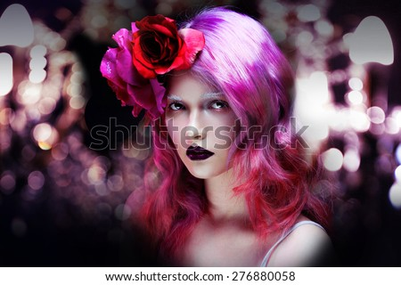 beautiful girl with pink hair, amid a festive flare - stock photo