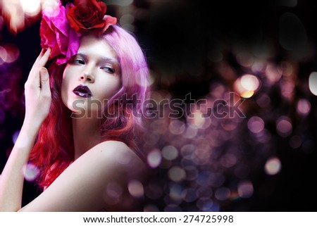 beautiful girl with pink hair,  amid the glare of light - stock photo