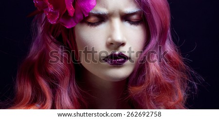 beautiful girl with pink hair, gloomy expression - stock photo