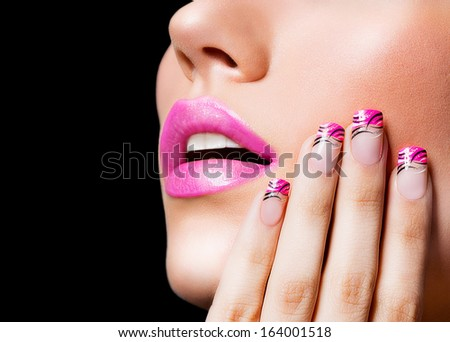 Beautiful girl with pink lips and nails on black background - stock photo