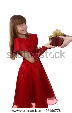Beautiful girl with present.Little girl gets gift.Attractive female is holding purple box with gold ribbon.Attractive lady is surprising at present.Isolated over white background.Schoolgirl feels shy. - stock photo