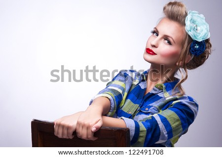 beautiful girl with pretty smile in pinup style - stock photo