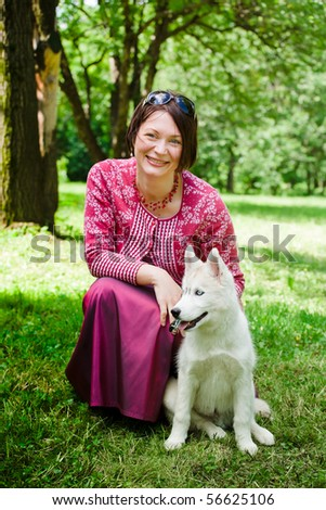 beautiful girl with puppy of husky in park