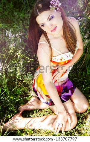 beautiful girl with purple flower. spring time