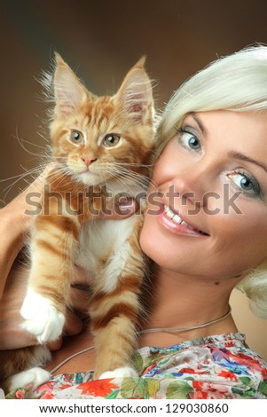 beautiful girl with red cat - stock photo