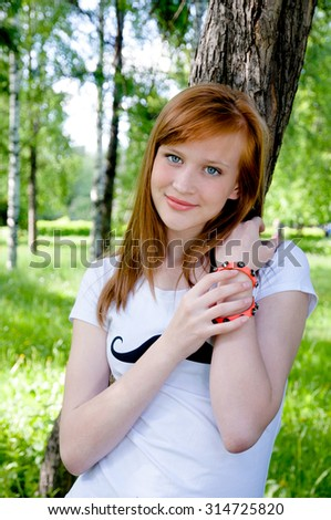 Beautiful girl with red hair like fire - stock photo