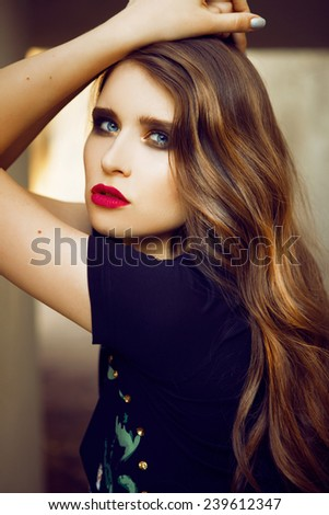 Beautiful girl with red lips and hands over the head , close-up portrait