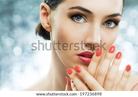 beautiful girl with red nails - stock photo