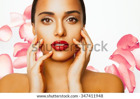 Beautiful girl with roses flowers. Beauty model woman face. Perfect skin. Professional Make-up and red lips .Makeup. Fashion art. Studio shot, horizontal - stock photo