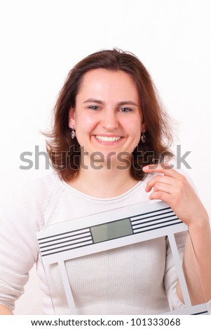 Beautiful girl with scales - stock photo