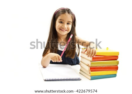 Beautiful girl with school books on the table. Isolated on white background - stock photo