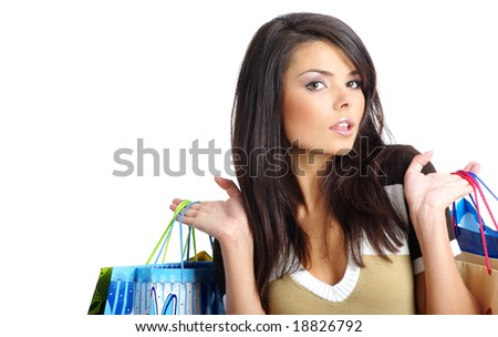 Beautiful girl with shopping bag - stock photo