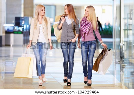 Beautiful girl with shopping bags in shop - stock photo