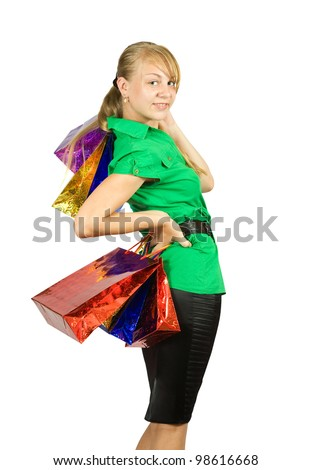 Beautiful girl with shopping bags. Isolated with clipping path - stock photo