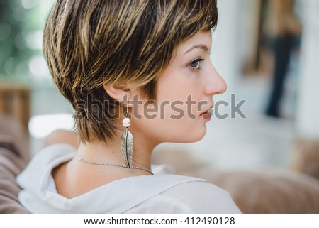 beautiful girl with short hair wearing a white shirt in the morning. portrait.  - stock photo