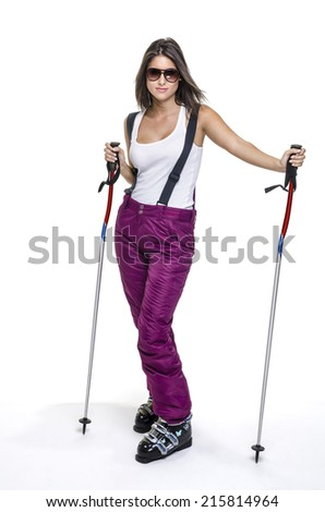 beautiful girl with ski poles in studio - stock photo
